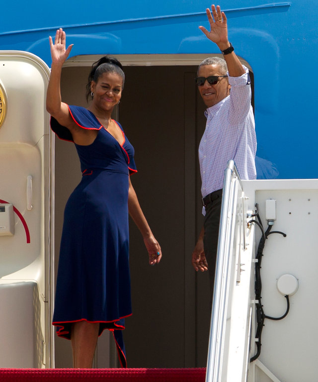 President Barack Obama accompanied by first lady Michelle Obama wave from Air Force One before departure at Andrews Air Force Base, Md., Saturday, Aug. 6, 2016. The first family is traveling to Martha's Vineyard for a family vacation. ( AP Photo/Jose Luis