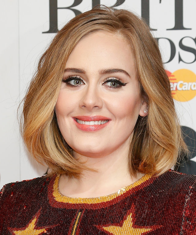 LONDON, ENGLAND - FEBRUARY 24:  Adele poses in the winners room at the BRIT Awards 2016 with her 4 Brit awards at The O2 Arena on February 24, 2016 in London, England.  (Photo by Luca Teuchmann/Getty Images)