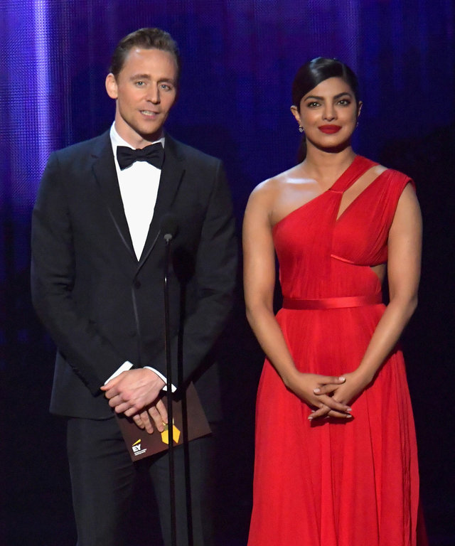 LOS ANGELES, CA - SEPTEMBER 18:  Actor Tom Hiddleston (L) and actress Priyanka Chopra speak onstage during the 68th Annual Primetime Emmy Awards at Microsoft Theater on September 18, 2016 in Los Angeles, California.  (Photo by Lester Cohen/WireImage)