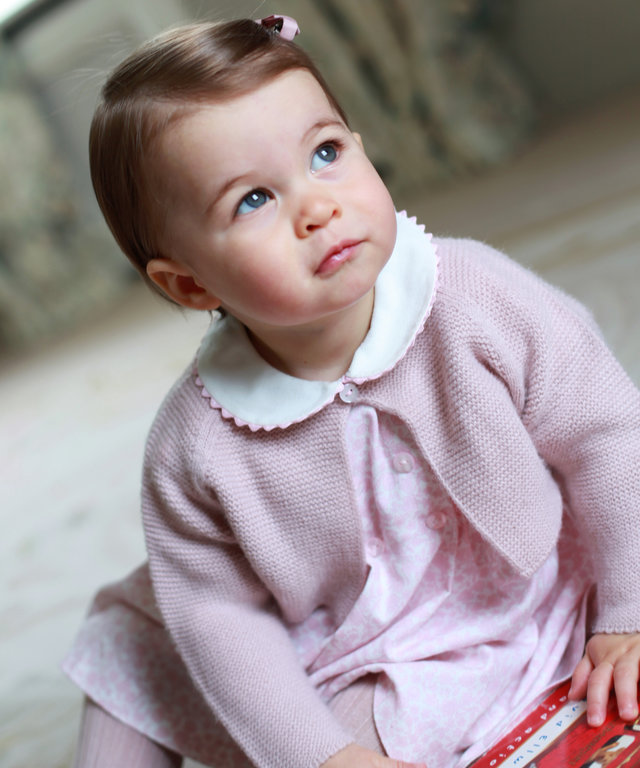 ANMER HALL, ENGLAND - APRIL 2016:  In this undated handout photo provided by HRH The Duke and Duchess of Cambridge released on May 1, 2016, Princess Charlotte of Cambridge looks up as her mother Catherine, Duchess of Cambridge takes her photo ahead of her