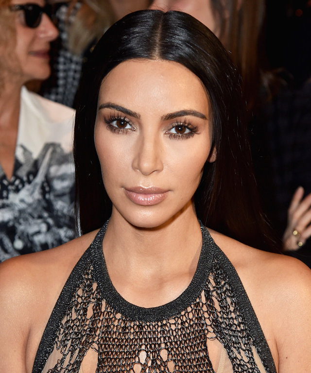Kim Kardashian West Sizzles in a Totally Sheer Outfit at Balmain's #PFW Front Row with Kourtney and Kris
