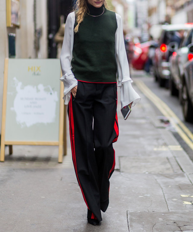 LONDON, ENGLAND - SEPTEMBER 18: Olivia Palermo wearing sunglasses, a green sleeveless jumper, white blouse, black track suit pants outside Mary Katrantzou during London Fashion Week Spring/Summer collections 2017 on September 18, 2016 in London, UK