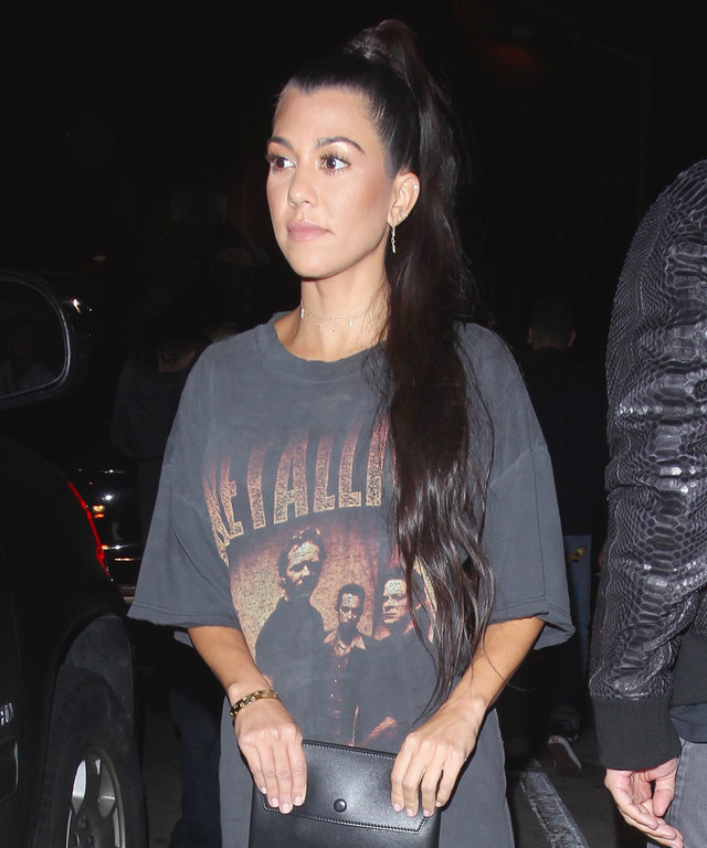 Kourtney Kardashian Redefines Concert Wear in Just an Oversize Tee and Thigh-High Boots
