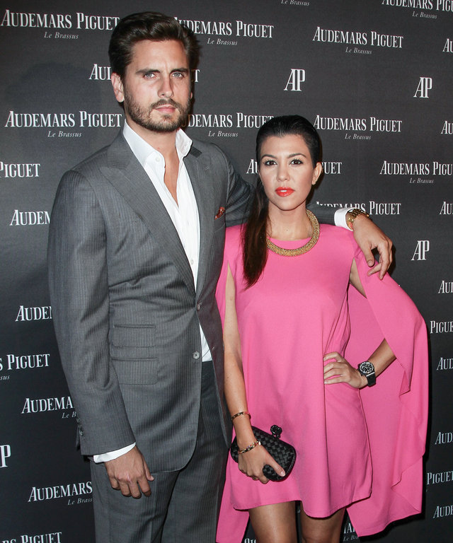 MIAMI BEACH, FL - SEPTEMBER 27: Scott Disick and Kourtney Kardashian attend a cocktail party to celebrate the launch of new watch for Audemars Piguet on September 27, 2013 in Miami Beach, Florida. (Photo by John Parra/WireImage)
