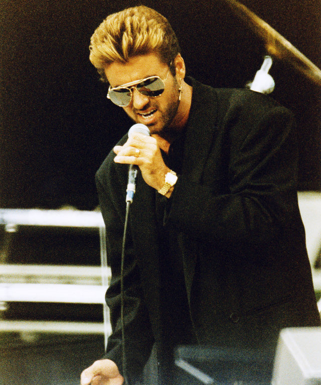 LONDON, UNITED KINGDOM - JUNE 11: George Michael performs on stage at The Nelson Mandela 70th Birthday Tribute concert, in Wembley Stadium on June 11th, 1988 in London, England. (Photo by Peter Still/Redferns)