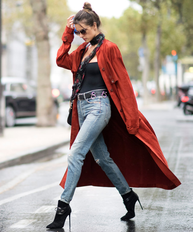 PARIS, FRANCE - SEPTEMBER 30: Alessandra Ambrosio is wearing Trussardi suede brick red coat, Saint Laurent floral scarf, Giuseppe Zanotti  chain belt, Citizens of Humanity vintage denim, Chloe bag, Le Sila black boots, Linda Farrow sunglasses, Are You Am