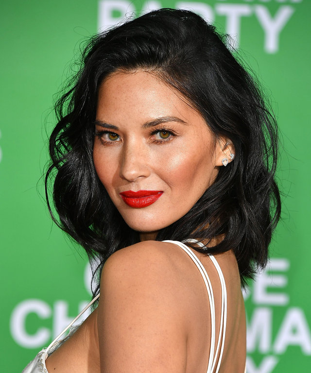 """WESTWOOD, CA - DECEMBER 07:  Olivia Munn arrives at the Premiere Of Paramount Pictures' """"Office Christmas Party"""" at Regency Village Theatre on December 7, 2016 in Westwood, California.  (Photo by Steve Granitz/WireImage)"""
