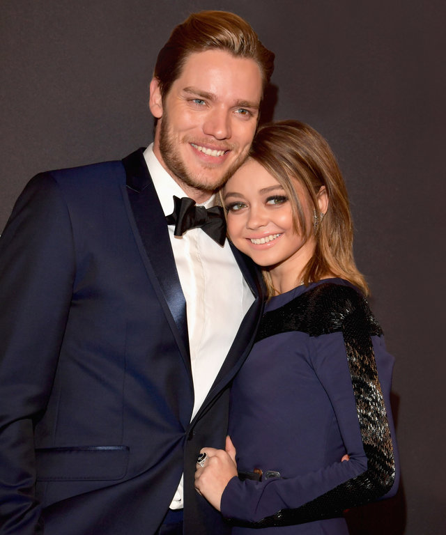 BEVERLY HILLS, CA - JANUARY 08:  Actors Dominic Sherwood (L) and Sarah Hyland attend the 18th Annual Post-Golden Globes Party hosted by Warner Bros. Pictures and InStyle at The Beverly Hilton Hotel on January 8, 2017 in Beverly Hills, California.  (Photo