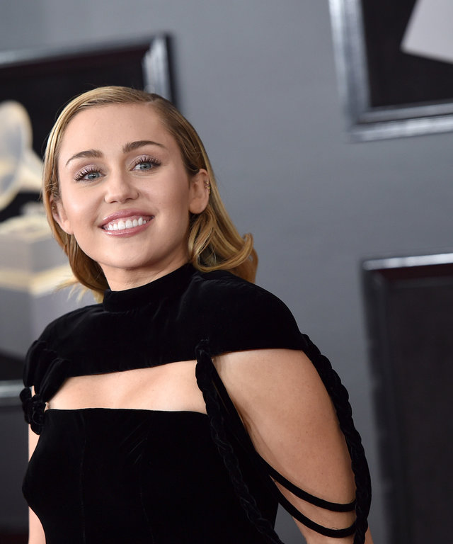 miley cyrus being sued by Flourgon