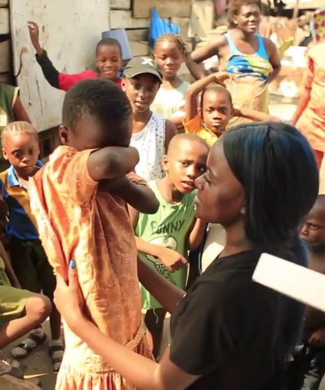 Girl crying after choreographer Sherrie Silver gifts her new shoes through her charity Children of Destiny