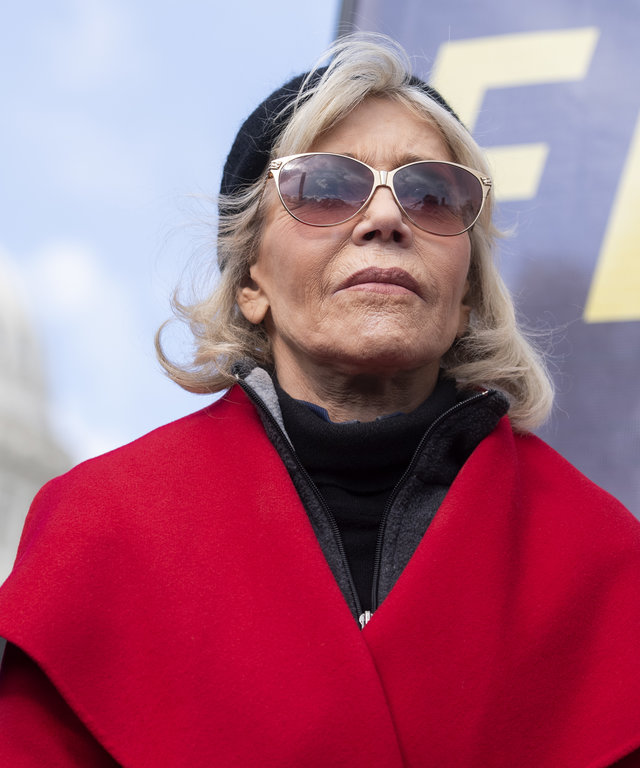 Jane Fonda protest in a red coat
