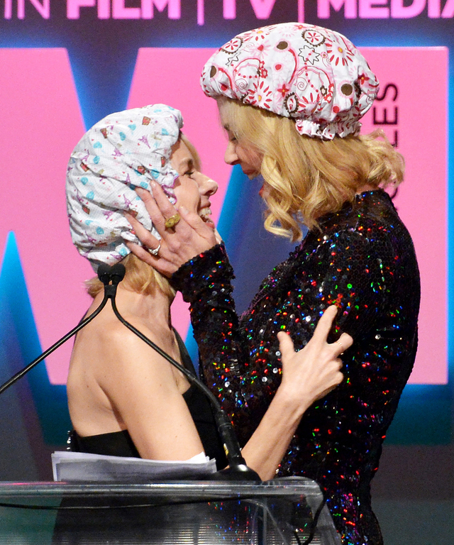 ctress Naomi Watts (L) and honoree Nicole Kidman, recipient of The Crystal Award for Excellence in Film, embrace onstage during the Women In Film 2015 Crystal + Lucy Awards Presented by Max Mara, BMW of North America, and Tiffany & Co. at the Hyatt Regenc
