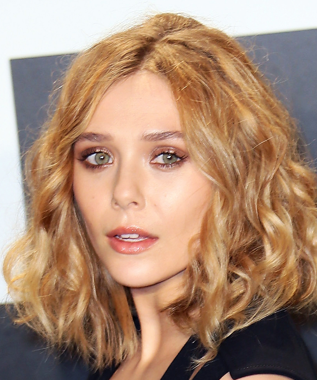 Actress Elizabeth Olsen attends the Tom Ford Autumn/Winter 2015 Womenswear Collection presentation at Milk Studios on February 20, 2015 in Hollywood, California.