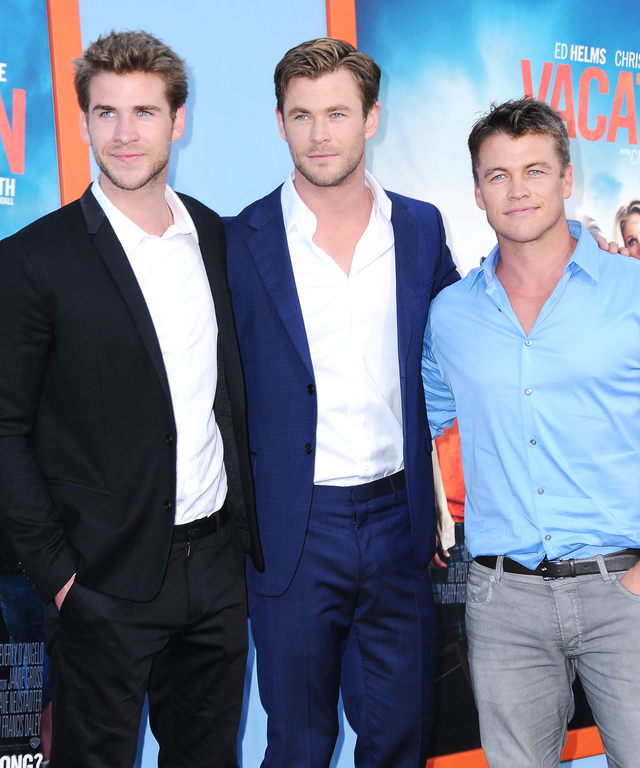 Actors/brothers Liam Hemsworth, Chris Hemsworth and Luke Hemsworth arrive at the Premiere Of Warner Bros. 'Vacation' at Regency Village Theatre on July 27, 2015 in Westwood, California.