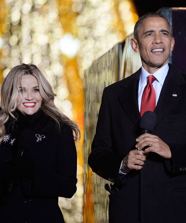 Actress Reese Witherspoon, from left, U.S. President Barack Obama and daughter Malia Obama attend the National Christmas Tree lighting ceremony on the Ellipse near the White House in Washington, D.C., U.S., on Thursday, Dec. 3, 2015. In 1923 President Cal