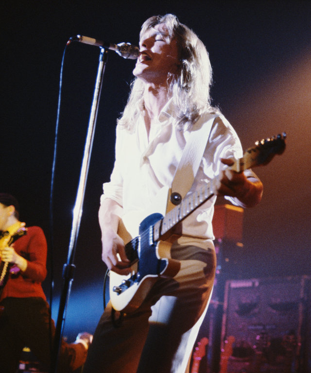 Robin Zander (left) and Tom Petersson performing on stage with American rock group Cheap Trick, circa 1979. On the far left and far right are guitarist Rick Nielsen and drummer Bun E. Carlos, respectively.