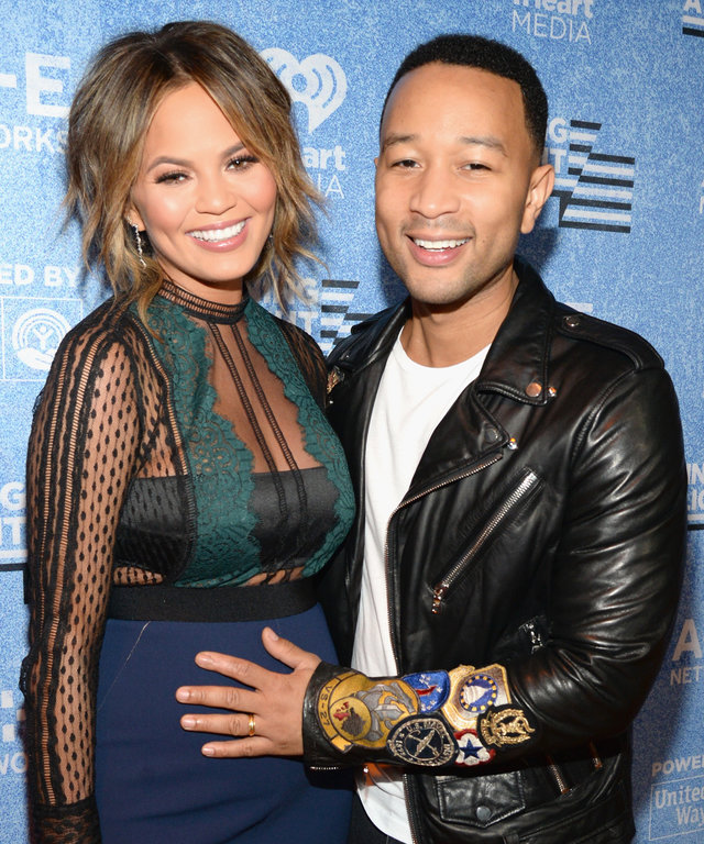 Model Chrissy Teigen (L) and recording artist John Legend attend A+E Networks 'Shining A Light' concert at The Shrine Auditorium on November 18, 2015 in Los Angeles, California.