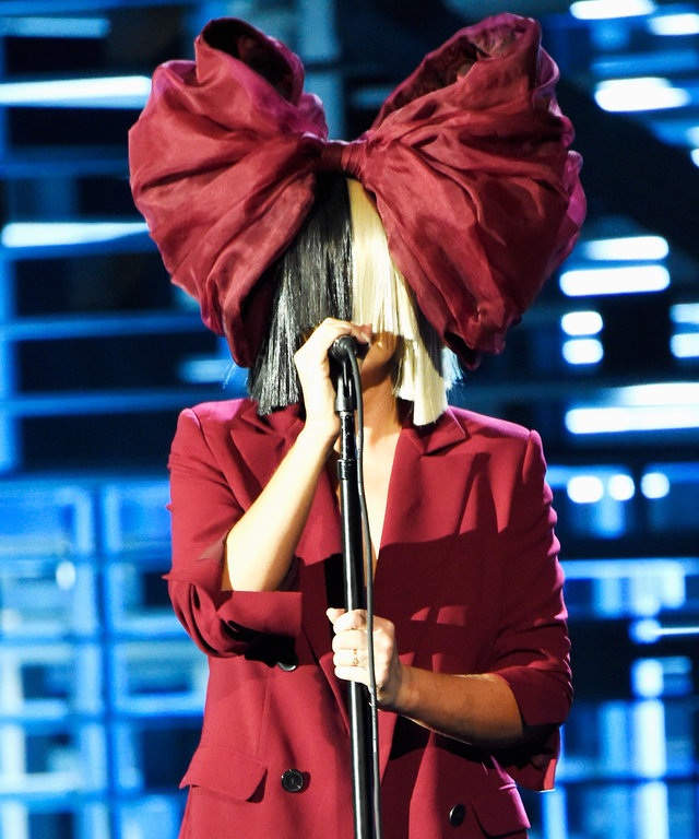 Recording artist Sia performs onstage at A+E Networks 'Shining A Light' concert at The Shrine Auditorium on November 18, 2015 in Los Angeles, California.