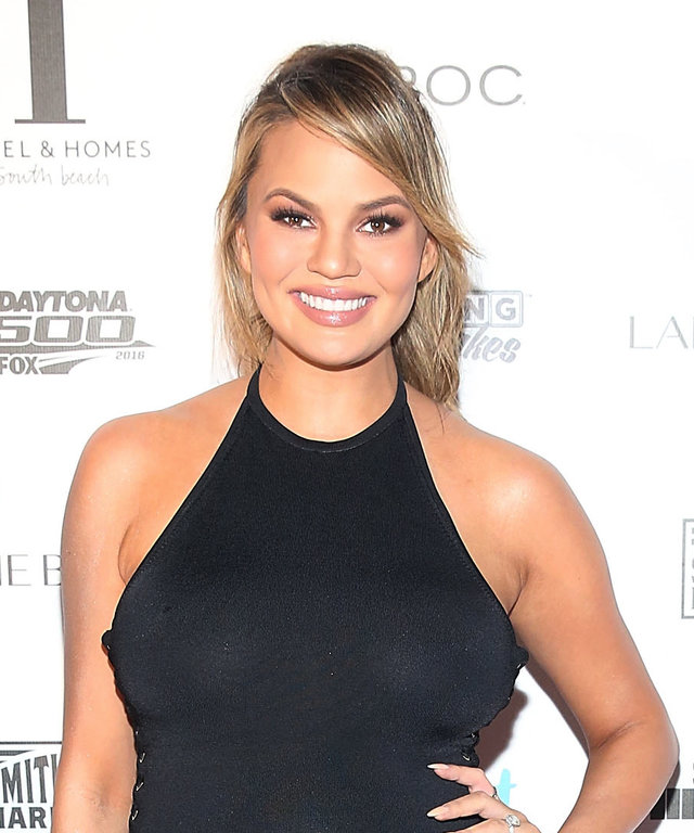 Chrissy Teigen attends Sports Illustrated Swimsuit 2016 - Swim BBQ VIP at 1 Hotel & Homes South Beach on February 17, 2016 in Miami Beach, Florida.
