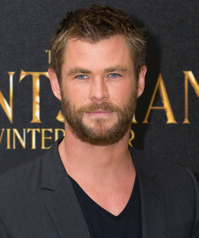 Australian actor Chris Hemsworth poses for pictures at a photocall to promote the film 'The Huntsman: Winter's War' in central London, on March 31, 2016.