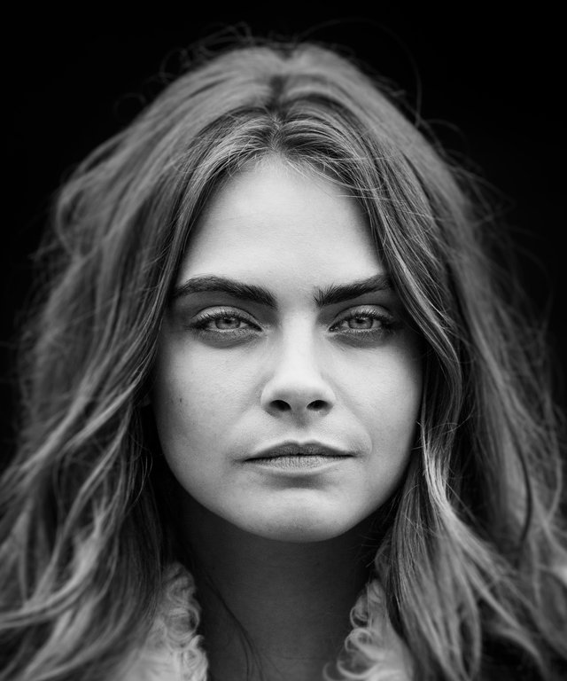 Fashion model Cara Delevingne is photographed on February 23, 2015 while attending Burberry Prorsum fashion show in London, England.
