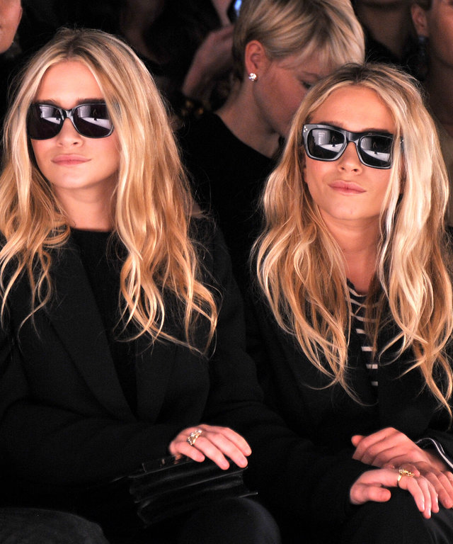 Ashley Olsen and Mary-Kate Olsen attend the J. Mendel Fall 2012 fashion show during Mercedes-Benz Fashion Week at The Theatre at Lincoln Center on February 15, 2012 in New York City.