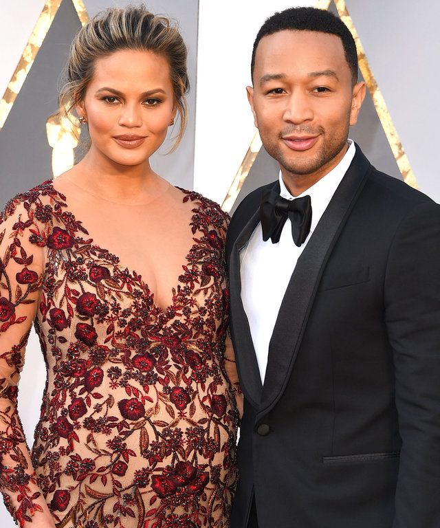 John Legend and Chrissy Teigen arrives at the 88th Annual Academy Awards at Hollywood & Highland Center on February 28, 2016 in Hollywood, California.