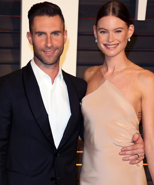 Recording artist Adam Levine (L) and wife model Behati Prinsloo attend the 2015 Vanity Fair Oscar Party hosted by Graydon Carter at the Wallis Annenberg Center for the Performing Arts on February 22, 2015 in Beverly Hills, California.