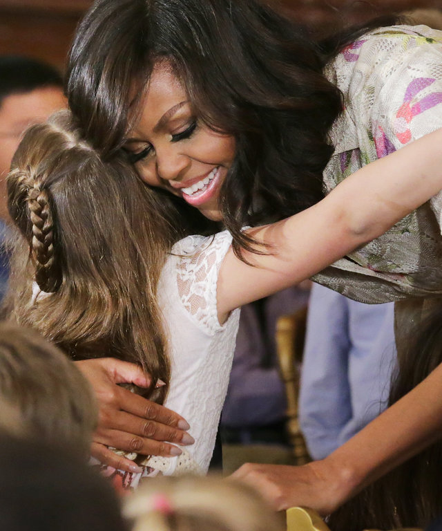 U.S. first lady Michelle Obama gives hugs to children for Take Our Daughters and Sons to Work Day in the East Room of the White House April 20, 2016 in Washington, DC. The children of Executive Office employees and young people from Big Brothers Big Siste