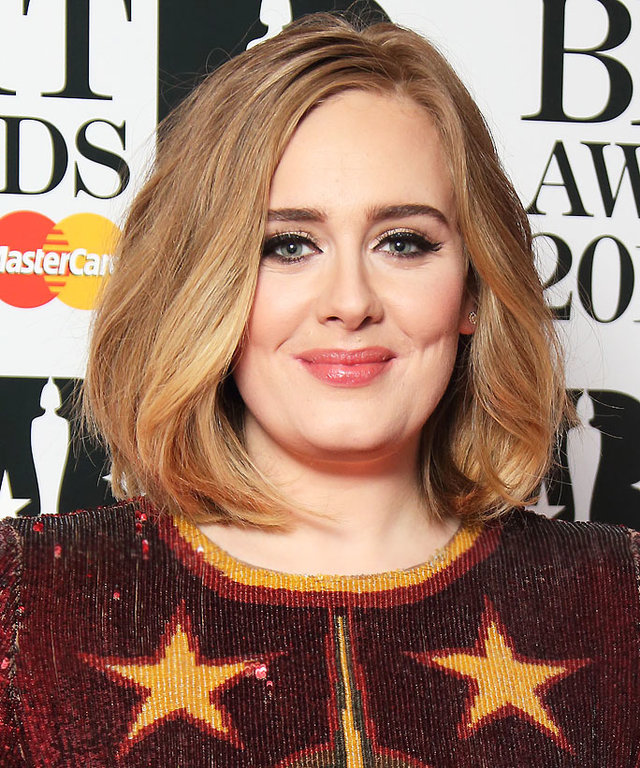 LONDON, ENGLAND - FEBRUARY 24: Adele poses in the winners room at the BRIT Awards 2016 at The O2 Arena on February 24, 2016 in London, England. (Photo by Mike Marsland/WireImage)