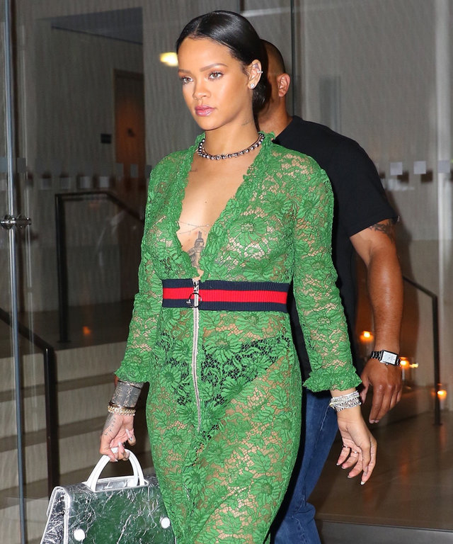 Rihanna enjoys a casual night out at The Edition Hotel in New York City. The Barbadian pop star wore a green Gucci cotton-blend lace dress with a ribbed-knit waistband, ruffled trims and polished two-way zip. She paired her dress with Gucci Finnlay leathe