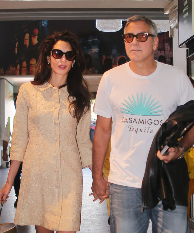 George and Amal Clooney leaving their hotel in Rome and arriving at the airport of Ciampino
