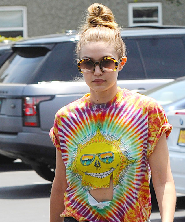 Kendall Jenner and Gigi Hadid are spotted going to a lunch date at Mauro's Cafe Fred Segal in West Hollywood. The young models are dressed casual for the day, Gigi wore a tie-dye tee with cut off denim shorts and white slip on sneakers while Kendall opte