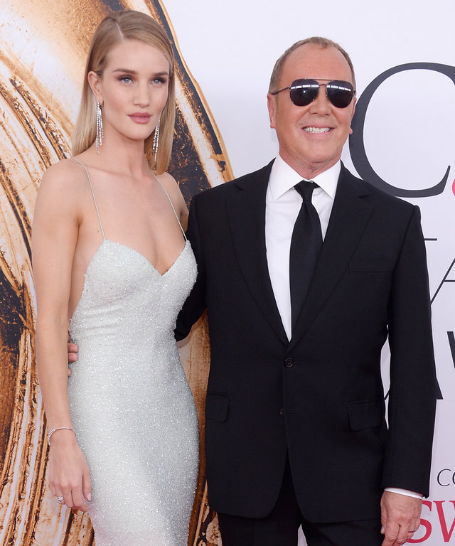 Model Rosie Huntington-Whiteley and (L) designer Michael Kors attend the 2016 CFDA Fashion Awards at the Hammerstein Ballroom on June 6, 2016 in New York City.