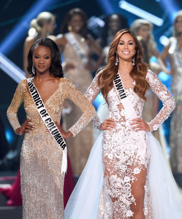 (L-R) Miss District of Columbia USA 2016 Deshauna Barber, Miss Hawaii USA 2016 Chelsea Hardin and Miss Georgia USA 2016 Emanii Davis compete in the top 3 during the 2016 Miss USA pageant at T-Mobile Arena on June 5, 2016 in Las Vegas, Nevada.
