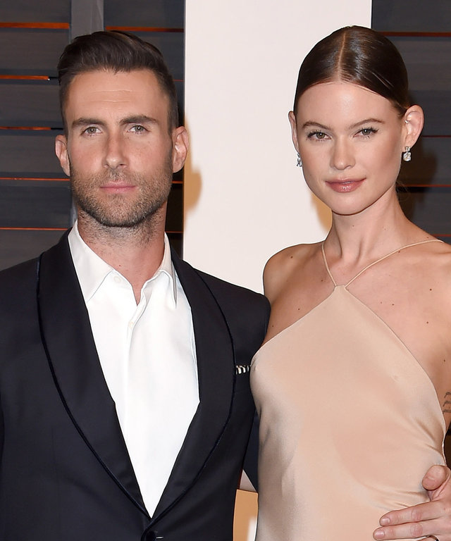Model Behati Prinsloo and musician Adam Levine arrive at the 2015 Vanity Fair Oscar Party Hosted By Graydon Carter at Wallis Annenberg Center for the Performing Arts on February 22, 2015 in Beverly Hills, California.