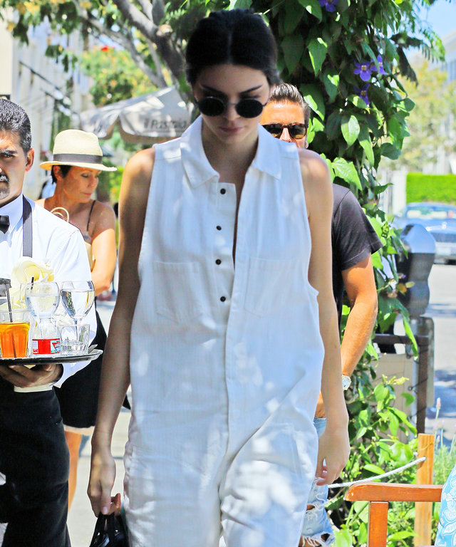 Kendall Jenner arrives to Il Pastaio with Scott Disick. The 20-year-old model is wearing a white jumpsuit paired with black ankle boots.