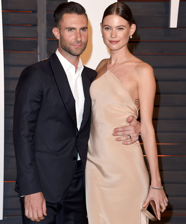 BEVERLY HILLS, CA - FEBRUARY 22:  Model Behati Prinsloo and musician Adam Levine arrive at the 2015 Vanity Fair Oscar Party Hosted By Graydon Carter at Wallis Annenberg Center for the Performing Arts on February 22, 2015 in Beverly Hills, California.  (Ph