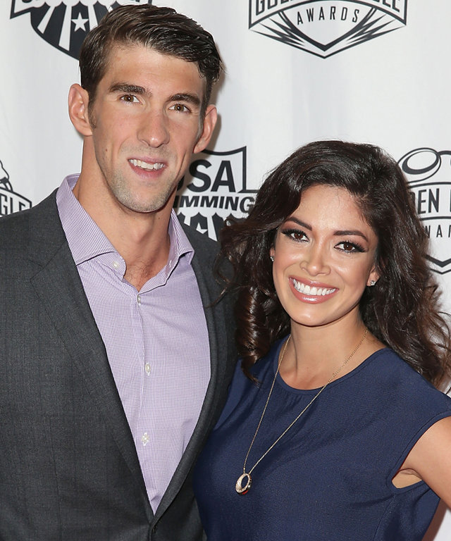 LOS ANGELES, CA - NOVEMBER 22:  Michael Phelps and Nicole Johnson attend the 2015 USA Swimming Golden Goggle Awards at J.W. Marriot at L.A. Live on November 22, 2015 in Los Angeles, California.  (Photo by Joe Scarnici/Getty Images)