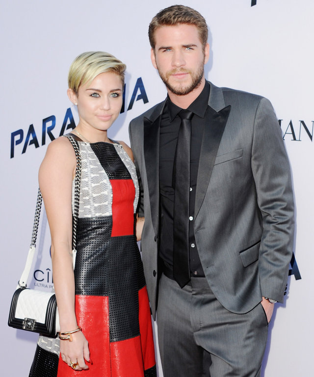 """LOS ANGELES, CA - AUGUST 08:  Singer Miley Cyrus and actor Liam Hemsworth arrive at the Los Angeles Premiere """"Paranoia"""" at DGA Theater on August 8, 2013 in Los Angeles, California.  (Photo by Jon Kopaloff/FilmMagic)"""