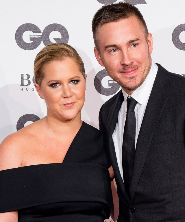 LONDON, ENGLAND - SEPTEMBER 06:  (L-R) Amy Schumer and Ben Hanisch arrive for GQ Men Of The Year Awards 2016 at Tate Modern on September 6, 2016 in London, England.  (Photo by Jeff Spicer/Getty Images)