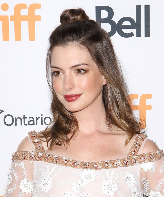 """TORONTO, ON - SEPTEMBER 09:  Anne Hathaway arrives at the 2016 Toronto International Film Festival - """"Colossal"""" premiere held at Ryerson Theatre on September 9, 2016 in Toronto, Canada.  (Photo by Michael Tran/Getty Images)"""