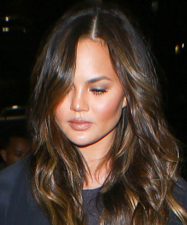 Chrissy Teigen Makes the Case for Monochromatic Airport Style While Jetting to N.Y.C.