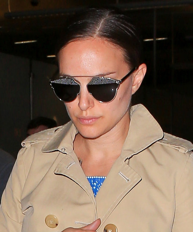 Natalie Portman Can't Quite Hide Her Baby Bump Under a Trench Coat at LAX