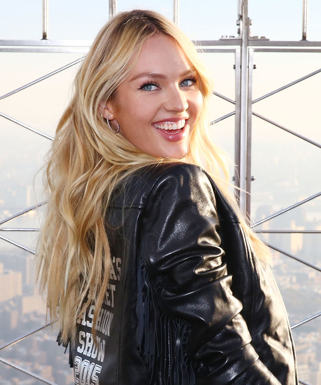 NEW YORK, NY - DECEMBER 07:  Victoria's Secret Angel Candice Swanepoel lights The Empire State Building In Pink Stripes on December 7, 2015 in New York City.  (Photo by Astrid Stawiarz/WireImage)
