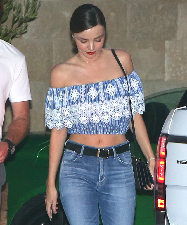 Miranda Kerr wore a cropped top with jeans for an afternoon at Soho House in Malibu.  Sunday, October 9, 2016 X17online.com