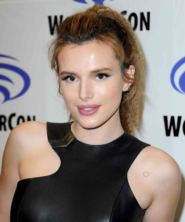 """LOS ANGELES, CA - MARCH 25:  Actress Bella Thorne promoting """"Ratchet and Clank"""" on Day 1 of WonderCon held at Los Angeles Convention Center on March 25, 2016 in Los Angeles, California.  (Photo by Albert L. Ortega/Getty Images)"""