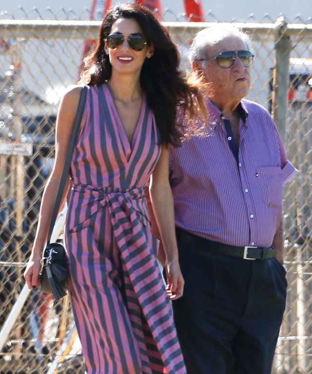 Amal Clooney Wows in Flowing Jumpsuit While Visiting George Clooney on Set