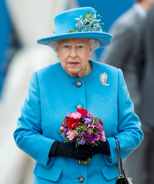 Queen Elizabeth II Stops by a Supermarket in a Bright Blue Coat and Matching Hat
