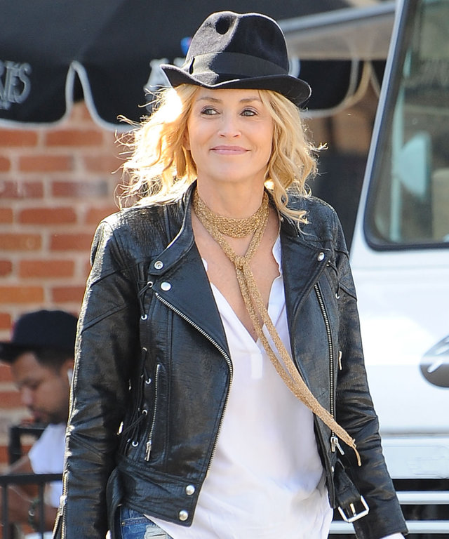 Sharon Stone Shows Off Her Flair for Edgy Fashion in a Black Leather Jacket and Chic Topper